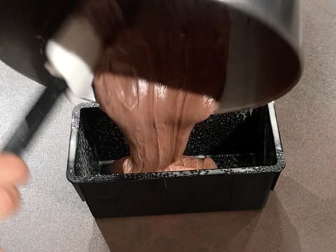 Pour the chocolate preparation into the greased bread pan