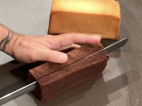 Cut a slice of sponge cake with the serrated knife