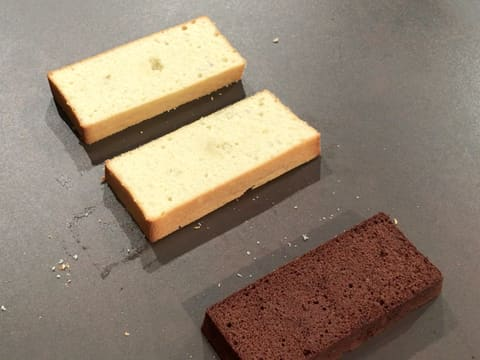Three sponge cake slices on the workbench