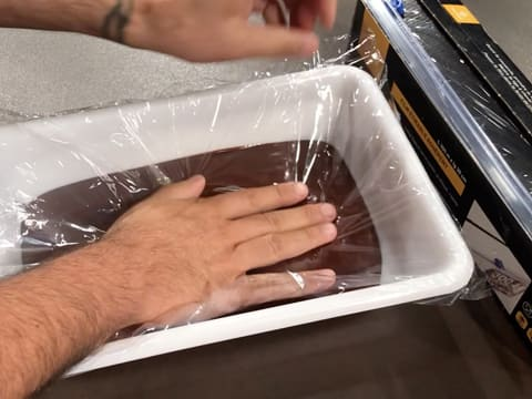 Cover the chocolate ganache with cling film