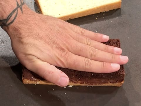 Press on the chocolate cake with your hand