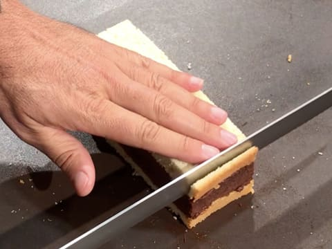Trim the crust on one end of the cake