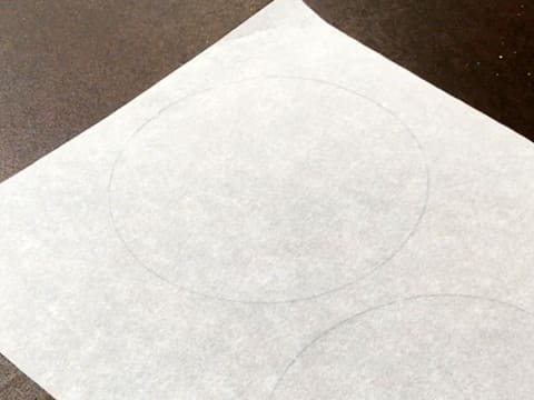 Flip the baking parchment on your workbench so the drawn circles are on the underside