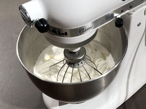 Whipped cream in the stand mixer bowl