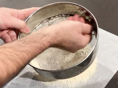 Press the ingredients in the sifter with your hand