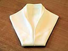 Folding napkins smoking jacket style