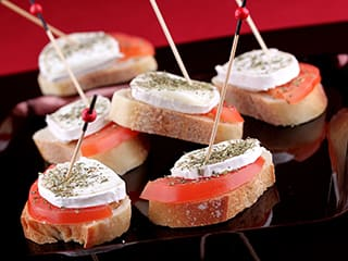 Fresh goat cheese and tomate tapas