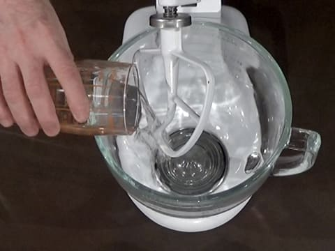 Pour water in stand mixer bowl fitted with flat beater