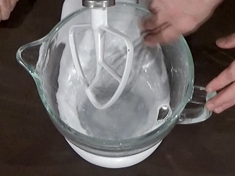 Combine salt and water with whisk