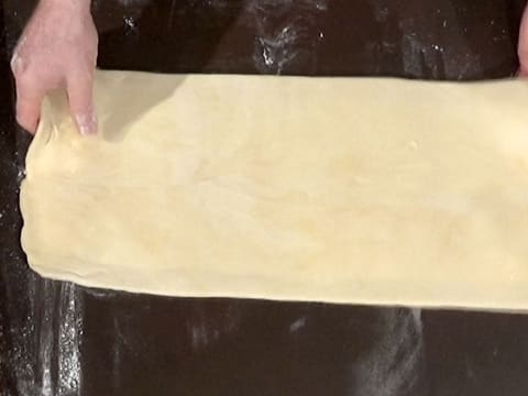 Place the dough horizontally on kitchen workbench