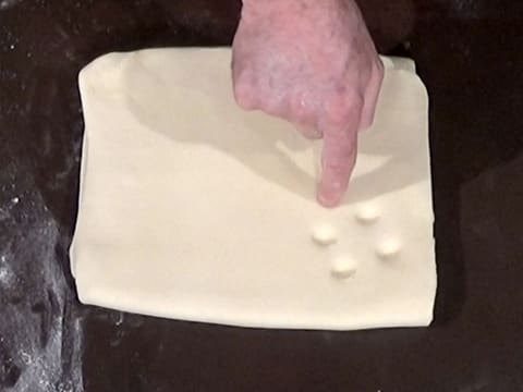 Make five finger marks in the dough