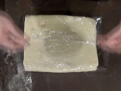 The dough is wrapped with cling film