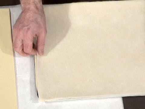 Cover the puff pastry with greaseproof paper