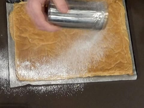 Sprinkle icing sugar over the puff pastry
