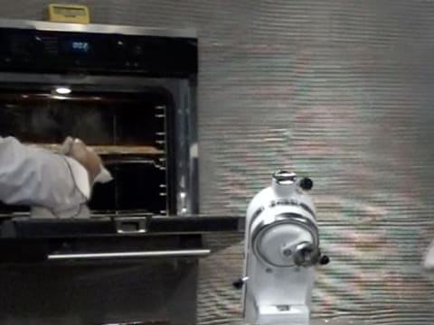 Open the oven door to check whether the pastry is cooked