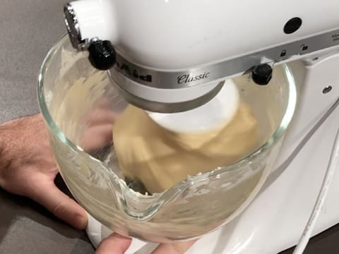 Kneading is in progress, the dough comes away from the sides of the bowl