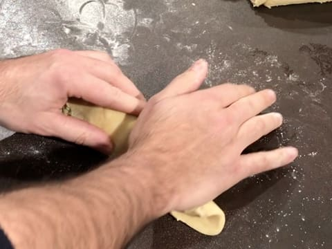 Flatten and roll the brioche ball with your hand on a floured surface