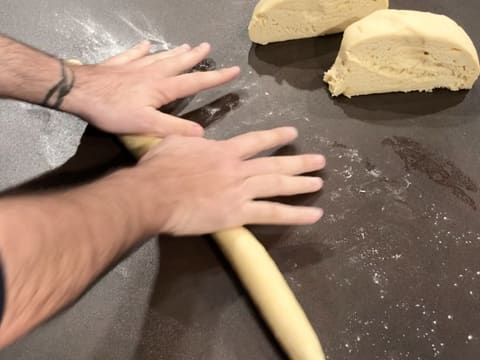 Roll the brioche dough with your hands on a floured surface