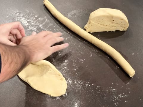 Flatten the second brioche ball with your hand on a floured surface