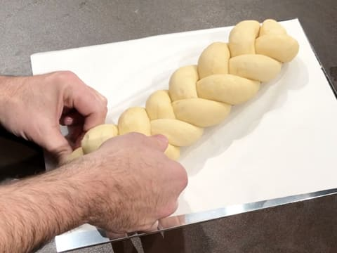 Place the plaited brioche on a baking sheet lined with greaseproof paper