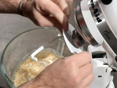 Place the bowl in the food mixer and attach the dough hook