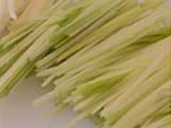 Trimming leeks into a julienne